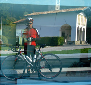 Madonna del Ghisallo reflected in the glass of the Museo del Ciclismo