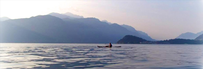 Photo of Kayaker in Lake Como with mount Grigna and Bellagio in the background